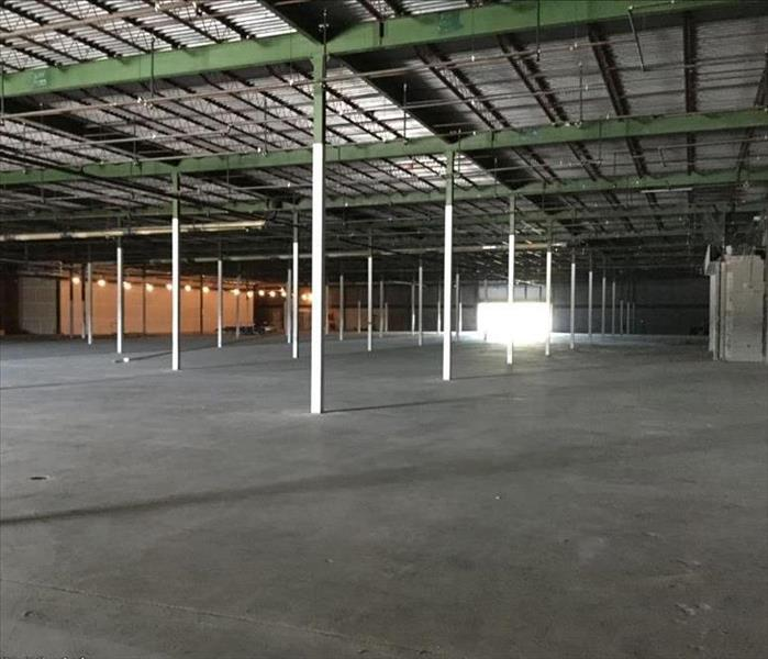a large pre-construction store with exposed beams and cement floors
