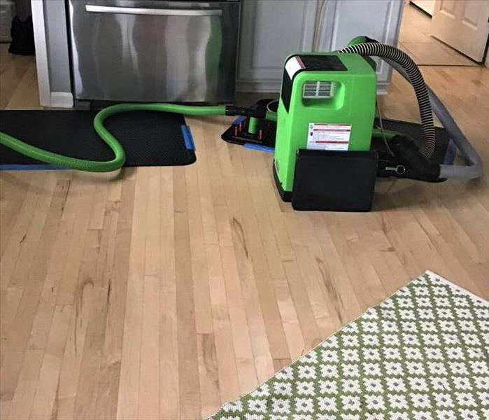 servpro floor mat systems drying water damaged wood floors