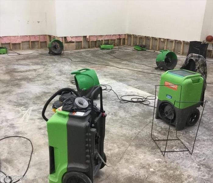 sport court with flooring removed and flood-cut after because of extreme flood damage - industrial air movers and humidifiers