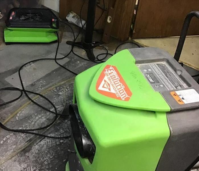 servpro drying fans and dehumidifiers drying out a basement from water damage