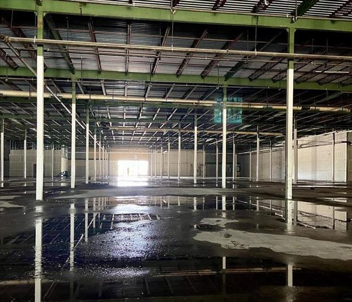 a large commercial structure with extreme water damage pre construction