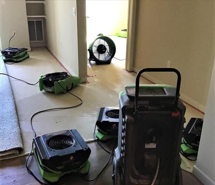 servpro drying fans and dehumidifiers in place to dry an apartment in verona, wi