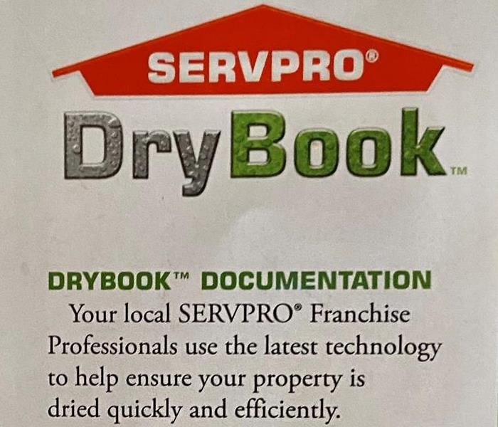 a graphic logo spelling SERVPRO DryBook