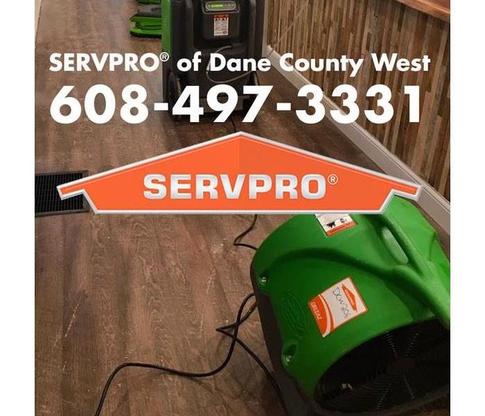green airmovers and humidifier with SERVPRO of Dane County West logo and phone number displayed