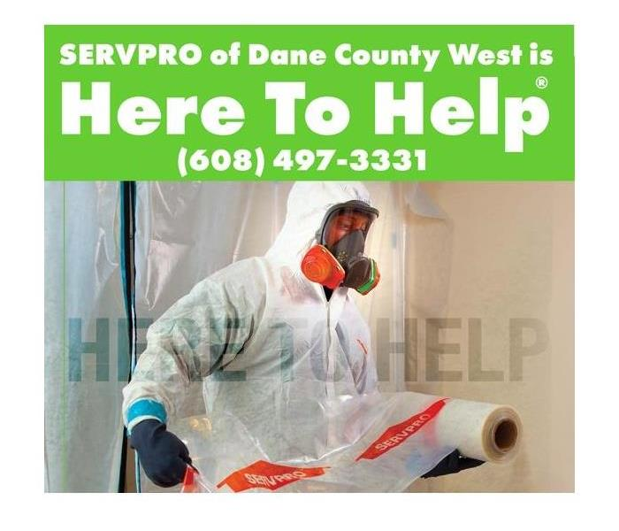 SERVPRO technician in hazmat suit for COVID-19 disinfection
