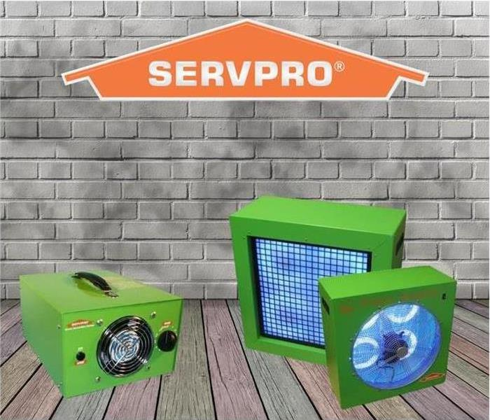 3 green ozone machines with an animated brick background with SERVPRO logo