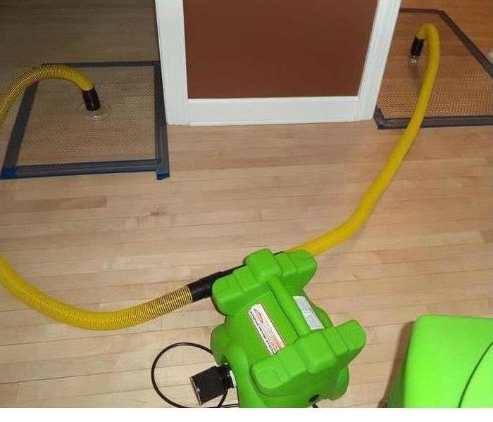 Water Damage SERVPRO Floor Drying System Used to Save Hardwood Floors