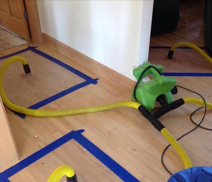 Storm Damage Utilizing Specialized Equipment to Save Hardwood Floor After Storm/Water Damage